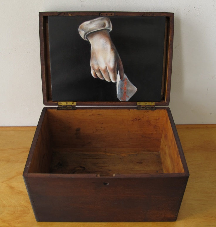 Oil on canvas with box.